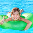 Child sitting on inflatable ring thumb up. — Stock Photo #5187633