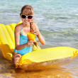 Child swimming on inflatable beach mattress. — Stock Photo #5187642