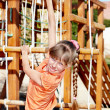 Stock Photo: Child climbing on slide.