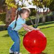 Little girl play with ball in the park — Stock Photo