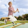 Little girl playing golf in park. — Stock Photo #5187685