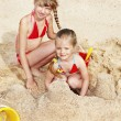 Children playing in sand — Stock Photo