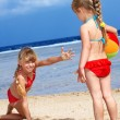 Stock Photo: Children playing on beach.