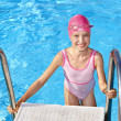Child swimming in pool. - Stockfoto