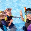 Children in swimming pool learning snorkeling. — Stock Photo #5187782