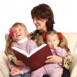 Grandmother and two granddaughter reading book. — Stock Photo #5187810