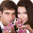 Couple of girl and man with flower. — Stock Photo