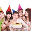 Group of happy young with cake. — Stockfoto