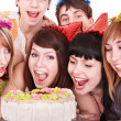 Group in party hat eat cake. — Stockfoto