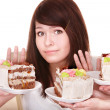 Stock Photo: Girl refuse to eat pie.