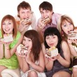 Group of happy young with cake. — Stock Photo