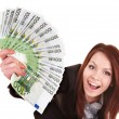 Young woman holding euro money. - Stock Photo