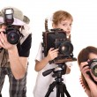 Photographer with his family taking picture. - Stock Photo