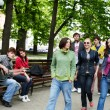 Group of in city park listen music. — Stock Photo