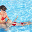 Stock Photo: Swimming Instructor learn child swim.