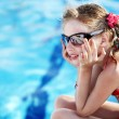 Child girl in red bikini and glasses near  swimming pool. — Foto Stock