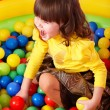 Child in group colourful ball. - Stock Photo