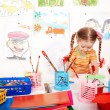 Stock Photo: Child with colour pencil in play room.