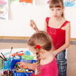 Children  prescooler with colour pencil in play room. -  