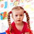 Child preschooler with pencil in play room. -  
