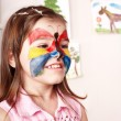 Stock Photo: Child making face painting.