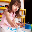 Child paint picture in preschool. — Stock Photo #5188293