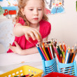 Child with pencil in play room. — Stock Photo #5188301