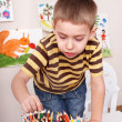 Child drawing pencil in play room. — Stock Photo