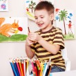 Child with pencil in play room. — Stock Photo #5188303