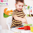 Stock Photo: Child paint picture in preschool.