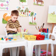Child paint picture in preschool. — Stockfoto