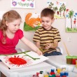 Children painting in play room. — Stok fotoğraf