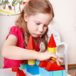 Child preschooler play wood block in play room. — Stock Photo #5188329