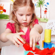Child preschooler play wood  block in play room. — Stockfoto