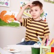 Stock Photo: Child paints in art class.