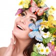 Girl with butterfly and flower on head. — Stock Photo #5188366