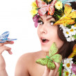Girl with butterfly and flower on head. — Stock Photo #5188376