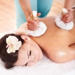 Girl having Thai herb compress massage. — Stock Photo #5188437