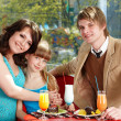 Happy family with child in restaurant. — Stock Photo