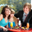 Happy family with child in restaurant. — Стоковое фото #5188602