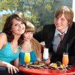 Happy family with child in restaurant. — 图库照片 #5188602