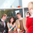 Group of  talking in cafe. - Stock Photo