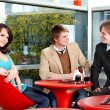 Group of talking in cafe. — Stock Photo