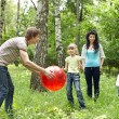 Outdoor happy family playing ball . — Stock Photo