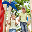 Children on slide outdoor in park. — Stock Photo #5188670