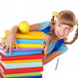 Schoolgirl with backpack holding pile of books. - Foto Stock