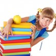 Schoolgirl with backpack holding pile of books. - Stockfoto
