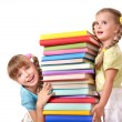 Children holding stack of book. — Stock Photo