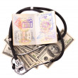 Medical still life with stethoscope, money and passport. — Stock Photo #5188754