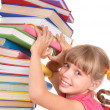 Child with pile of books. - Stock Photo